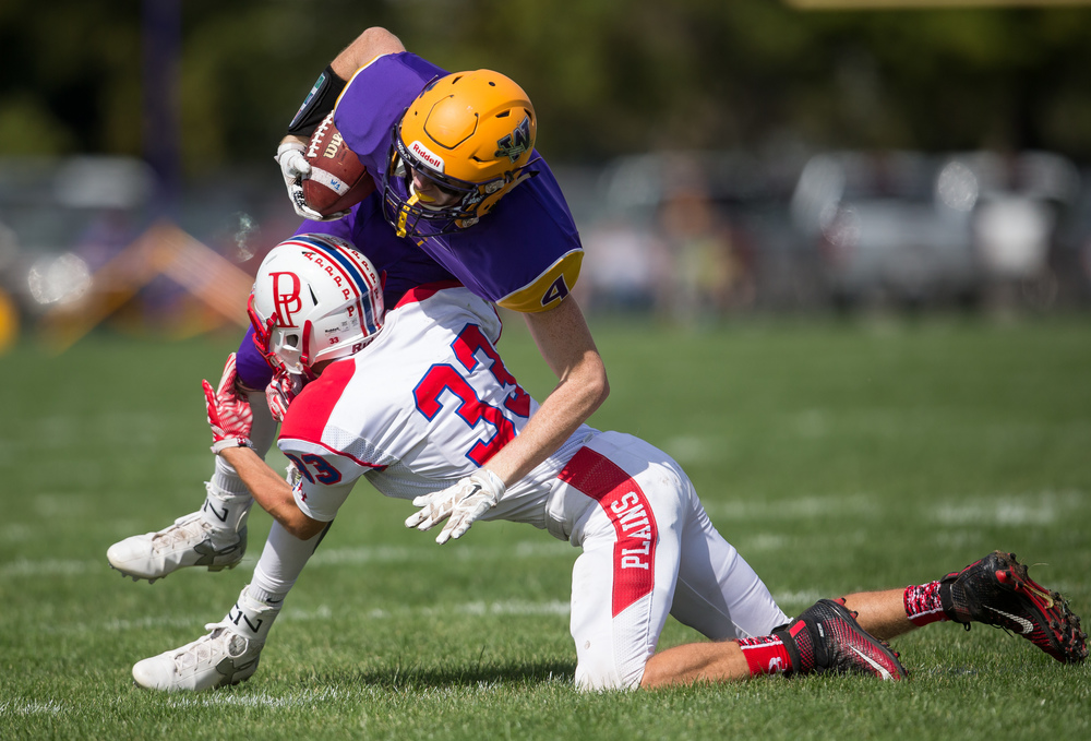 Williamsville's Harrison Creswell (4) is upended by Pleasant Plains' David Shultz (33) after a catch during the second half at Paul Jenkins Field, Saturday, Sept. 19, 2015, in Williamsville, Ill. Justin L. Fowler/The State Journal-Register