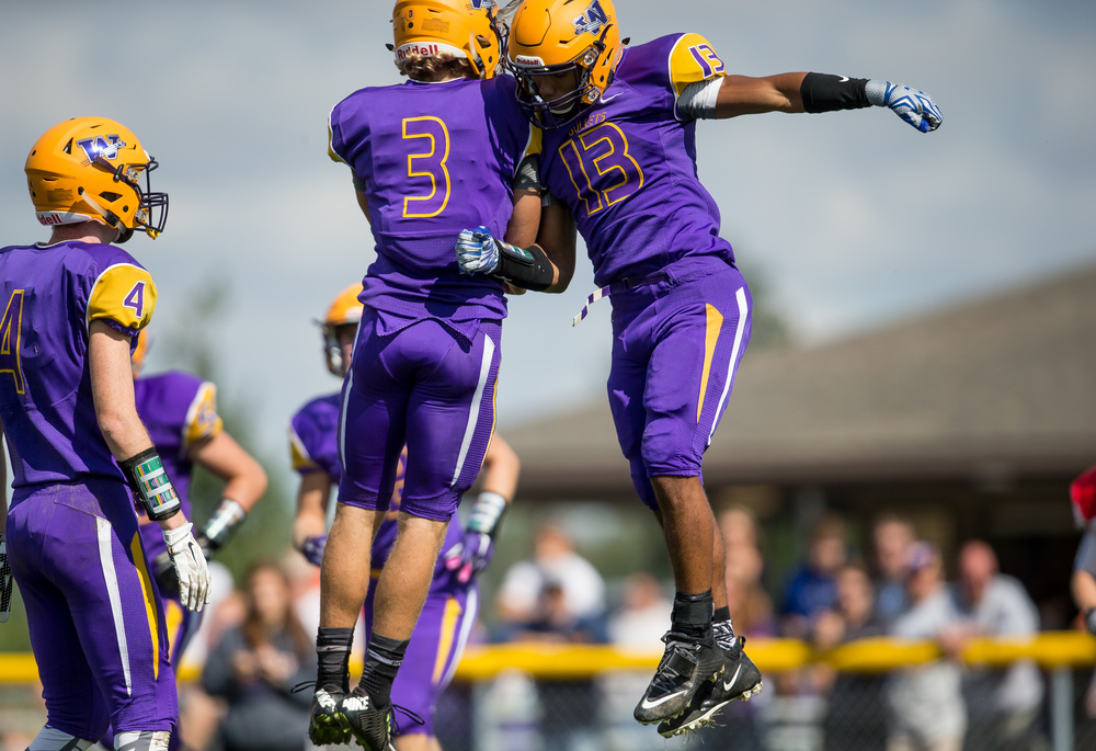 After scoring a 14-yard touchdown Williamsville's Jace Franklin (13) celebrates with quarterback Vince Vignali (3) to make it 32-22 Pleasant Plains during the second half at Paul Jenkins Field, Saturday, Sept. 19, 2015, in Williamsville, Ill. Justin L. Fowler/The State Journal-Register