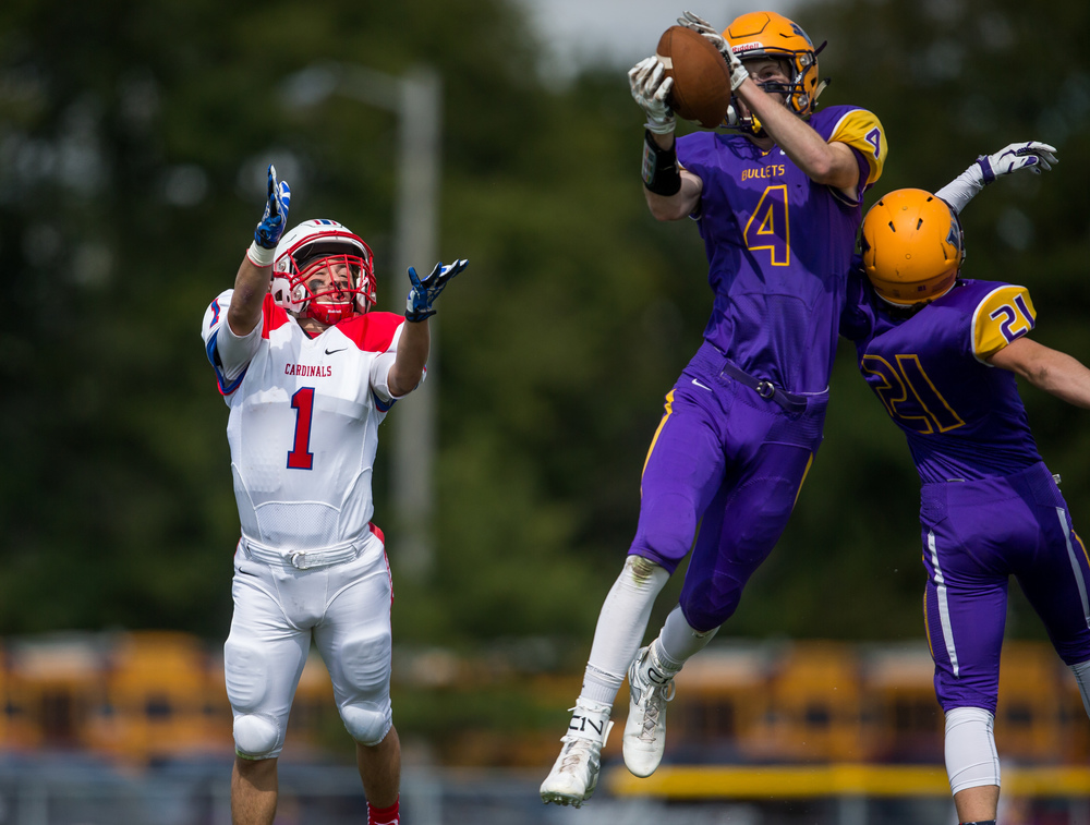 Williamsville's Harrison Creswell (4) intercepts a pass intended for Pleasant Plains' Cole Greer (1) during the second half at Paul Jenkins Field, Saturday, Sept. 19, 2015, in Williamsville, Ill. Justin L. Fowler/The State Journal-Register