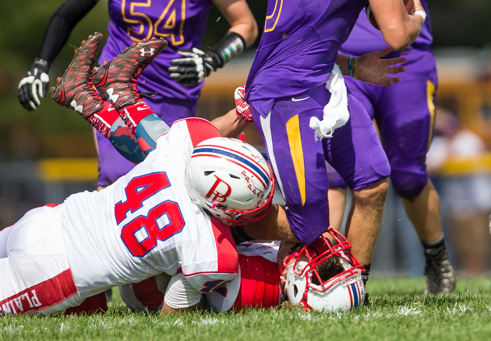 Pleasant Plains' Mason Kauffman (11) takes a knee to the face from Williamsville's Vince Vignali (3) after loosing his helmet trying to tackle Vignali on a rush during the second half at Paul Jenkins Field, Saturday, Sept. 19, 2015, in Williamsville, Ill. Justin L. Fowler/The State Journal-Register