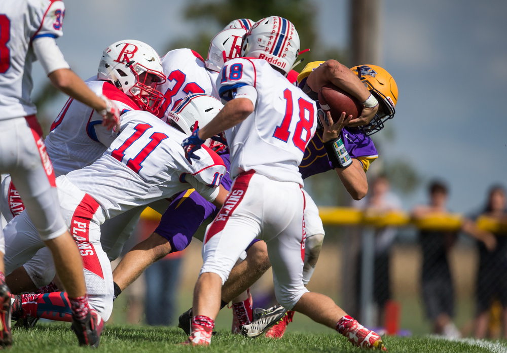 Williamsville quarterback Vince Vignali (3) drags a plethora of the Pleasant Plains defense into the end zone for a 14-yard touchdown to give the Bullets a 35-32 lead during the second half at Paul Jenkins Field, Saturday, Sept. 19, 2015, in Williamsville, Ill. Justin L. Fowler/The State Journal-Register