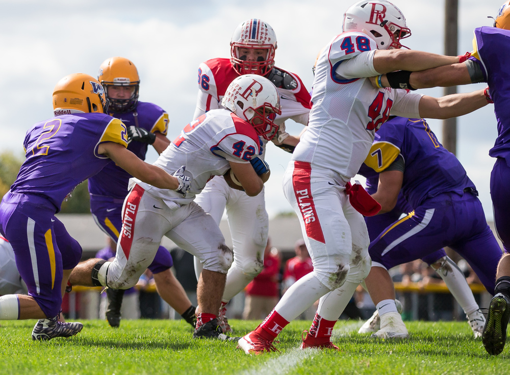 Pleasant Plains's Nik Georges (42) finds a hole in the Williamsville defense and goes in for the 5-yard touchdown to put the Cardinals up 39-36 during the second half at Paul Jenkins Field, Saturday, Sept. 19, 2015, in Williamsville, Ill. Justin L. Fowler/The State Journal-Register