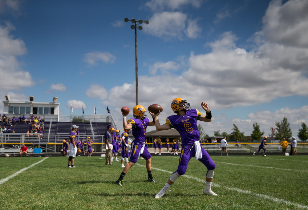Williamsville's Justice Ferrier (8) and Vince Vignali (3) get warmed up prior to resuming their game against Pleasant Plains at Paul Jenkins Field, Saturday, Sept. 19, 2015, in Williamsville, Ill. Justin L. Fowler/The State Journal-Register