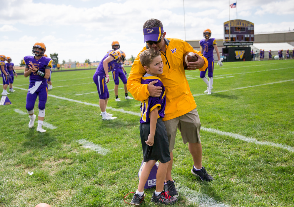 Williamsville head football coach Aaron Kunz hugs his son, Seth, along the sideline as the Bullets prepare to resume their game against Pleasant Plains at Paul Jenkins Field, Saturday, Sept. 19, 2015, in Williamsville, Ill. Justin L. Fowler/The State Journal-Register