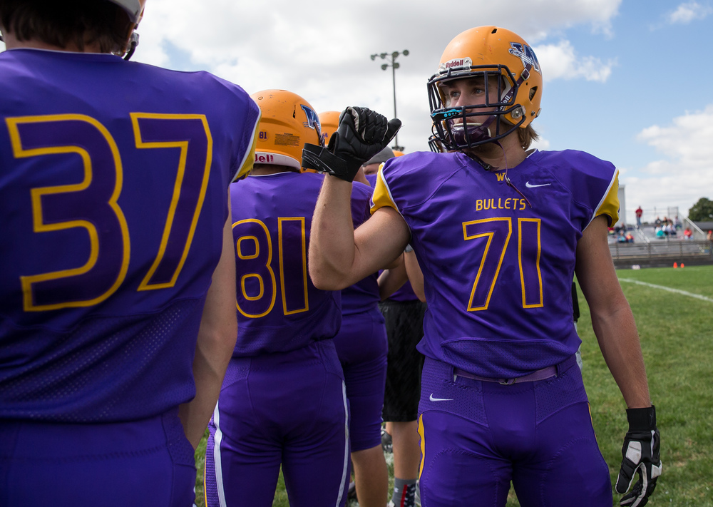 Williamsville's Braden Hewitt (71) walks the line formed by his teammates giving them all a fist bump prior to resuming their game against Pleasant Plains at Paul Jenkins Field, Saturday, Sept. 19, 2015, in Williamsville, Ill. Justin L. Fowler/The State Journal-Register
