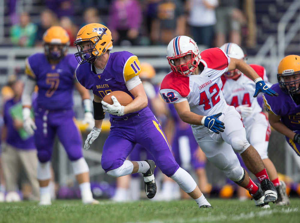 Williamsville's Jacob Sexton (11) evades a tackle from Pleasant Plains' Nik Georges (42) on a rush during the second half at Paul Jenkins Field, Saturday, Sept. 19, 2015, in Williamsville, Ill. Justin L. Fowler/The State Journal-Register