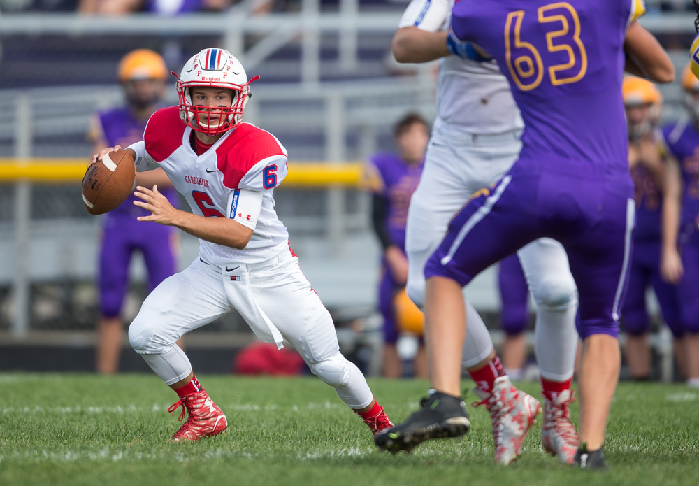 Pleasant Plains quarterback Jacob Cronister (6) scrambles out of the pocket under pressure from Williamsville during the second half at Paul Jenkins Field, Saturday, Sept. 19, 2015, in Williamsville, Ill. Justin L. Fowler/The State Journal-Register