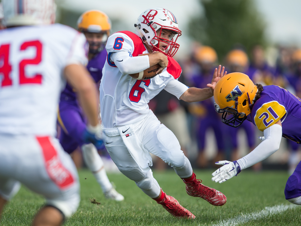 Pleasant Plains quarterback Jacob Cronister (6) tries to cut away from the tackle from Williamsville's Cade Beckett (21)  on a rush during the second half at Paul Jenkins Field, Saturday, Sept. 19, 2015, in Williamsville, Ill. Justin L. Fowler/The State Journal-Register