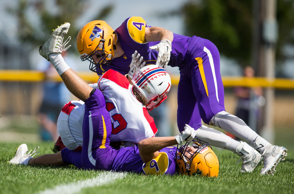 Williamsville's Dane Rockford (6) and Harrison Creswell (4) stop Pleasant Plains' Daulton Nibbe (12) just short of the goal line after a reception during the second half at Paul Jenkins Field, Saturday, Sept. 19, 2015, in Williamsville, Ill. Justin L. Fowler/The State Journal-Register