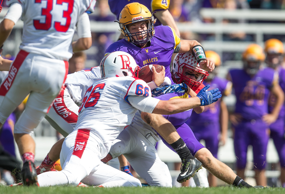 Williamsville quarterback Vince Vignali (3) is brought down by a trio of Pleasant Plains defenders on a rush during the second half at Paul Jenkins Field, Saturday, Sept. 19, 2015, in Williamsville, Ill. Justin L. Fowler/The State Journal-Register