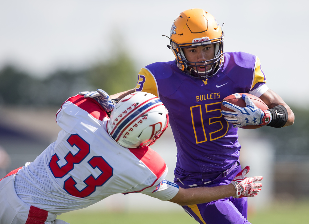 Williamsville's Jace Franklin (13) tries to put a stiff arm on Pleasant Plains' David Schultz (33) on a rush during the second half at Paul Jenkins Field, Saturday, Sept. 19, 2015, in Williamsville, Ill. Justin L. Fowler/The State Journal-Register