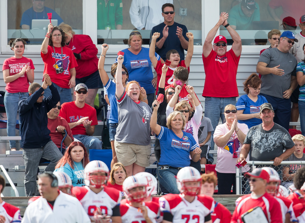 Pleasant Plains fans cheer on the team as they take over leading Williamsville 39-36 with a minute left during the second half at Paul Jenkins Field, Saturday, Sept. 19, 2015, in Williamsville, Ill. Justin L. Fowler/The State Journal-Register
