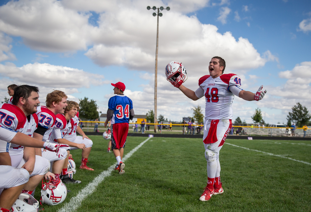 Pleasant Plains' Brock Hergenrother (48) celebrates the Cardinals 39-36 victory over Williamsville with his teammates at Paul Jenkins Field, Saturday, Sept. 19, 2015, in Williamsville, Ill. Justin L. Fowler/The State Journal-Register