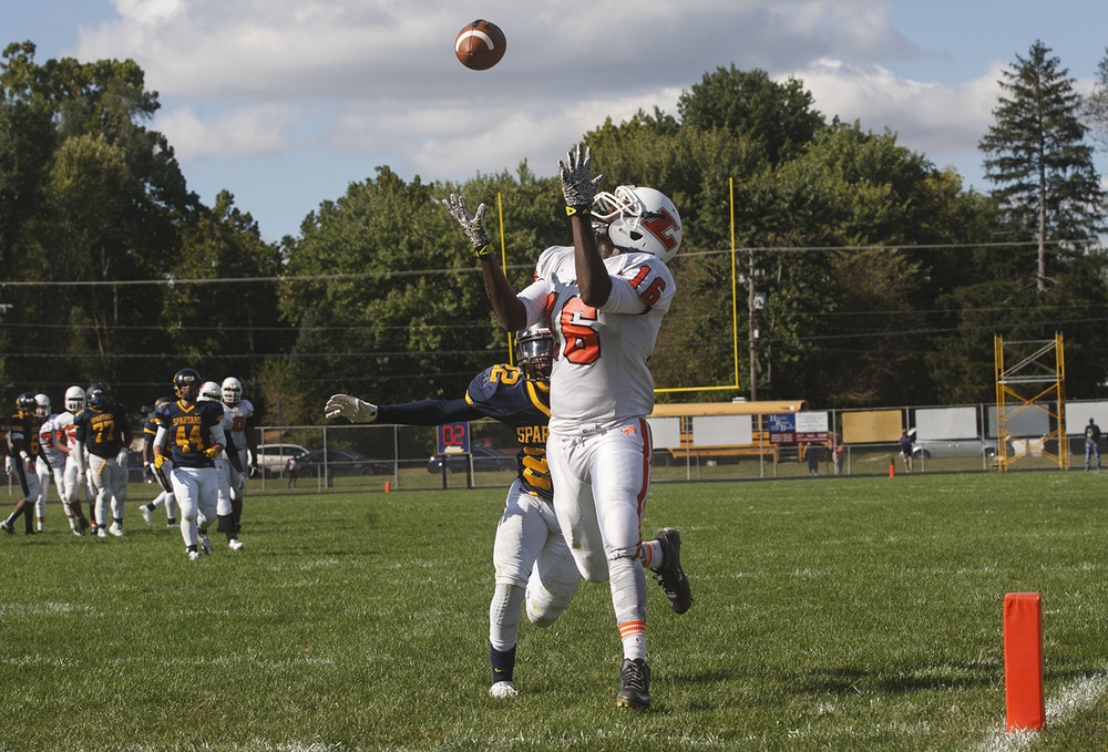 Lanphier's Corrington Jones hauls in a touchdown pass in front of Southeast's Don Readus at Southeast High School Saturday, Sept. 19, 2015. Ted Schurter/The State Journal-Register