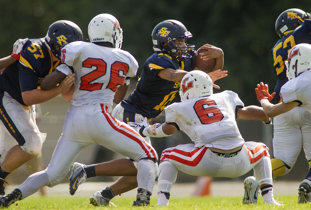 Southeast's Eddie Gailes looks for a hole in the Lanphier defense at Southeast High School Saturday, Sept. 19, 2015. Ted Schurter/The State Journal-Register