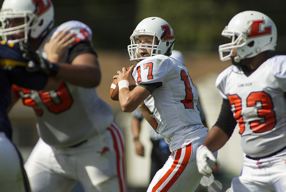 Lanphier quarterback Joseph Varela looks for an open reciever against Southeast at Southeast High School Saturday, Sept. 19, 2015. Ted Schurter/The State Journal-Register