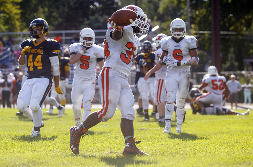 Lanphier's JacAnthony Childress strides into the endzone after being found wide open by quarterback Joseph Varela in the second half against Southeast at Southeast High School Saturday, Sept. 19, 2015. Ted Schurter/The State Journal-Register