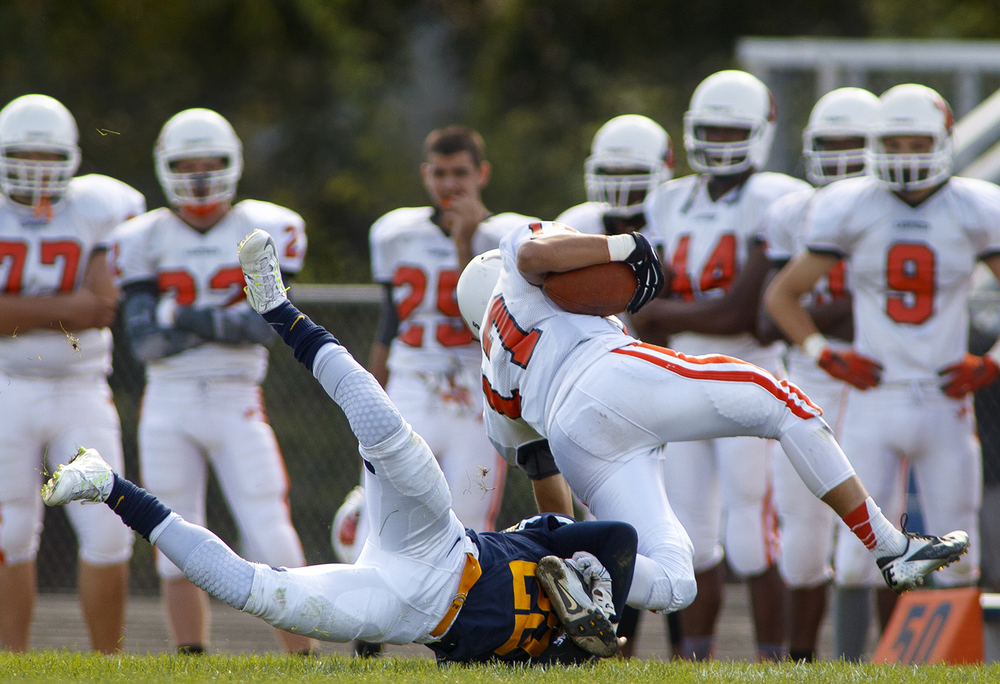 Southeast's Don Readus snags Lanphier quarterback Joseph Varela by the leg in the second half at Southeast High School Saturday, Sept. 19, 2015. Ted Schurter/The State Journal-Register