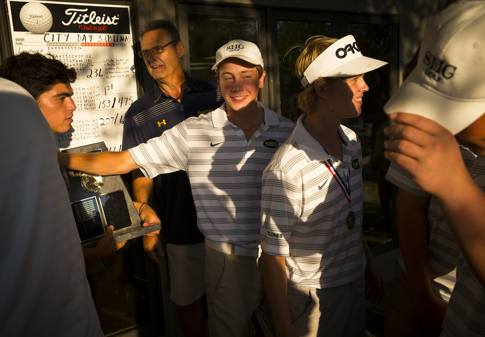 Sacred Heart-Griffin's Clayton Luker, center, celebrates with his team after they took home the team title during the Boys City Golf Tournament at Bunn Golf Course, Thursday, Sept. 17, 2015, in Springfield, Ill. Justin L. Fowler/The State Journal-Register
