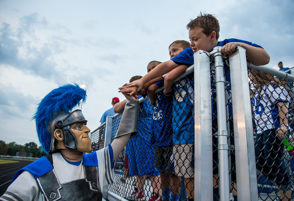 The Auburn Trojan gets high fives prior to kick off against North Mac at Michael J. Potts Memorial Field, Friday, Sept. 18, 2015, in Auburn, Ill. Justin L. Fowler/The State Journal-Register