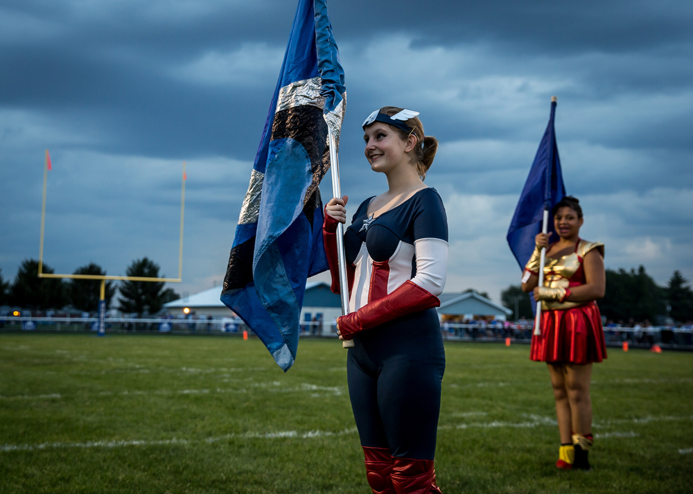 Elizabeth Davis, center, and Shacorria Ford, right, dressed in the Marvel Comics theme for their performance with the Auburn High School Marching Band for the Auburn vs. North Mac football game at Michael J. Potts Memorial Field, Friday, Sept. 18, 2015, in Auburn, Ill. Justin L. Fowler/The State Journal-Register