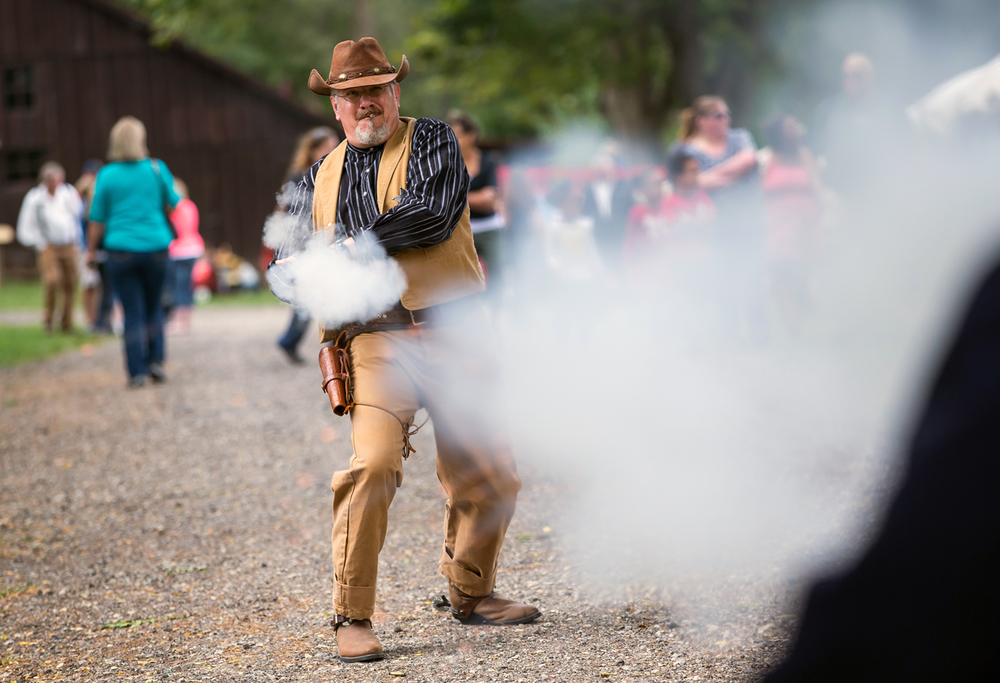 Jeff Bair, of Hudson, Ill., portraying U.S. Marshall Killin, fires his pistol in gun duel reenactment during the Clayville Fall Festival at the Clayville Historical Site, Friday, Sept. 18, 2015, in Pleasant Plains, Ill. Justin L. Fowler/The State Journal-Register