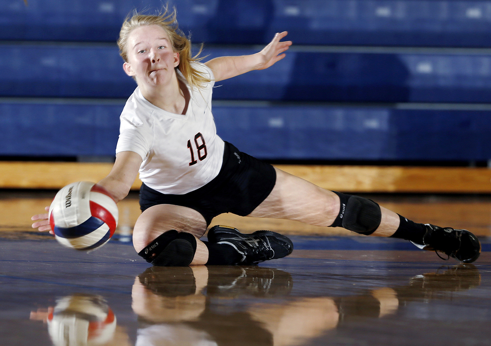 Lanphier's Rylee Cook dives for the ball as the Lions face Springfield during the Girls City Tournament at Southeast High School Monday Sept. 21, 2015. Ted Schurter/The State Journal-Register