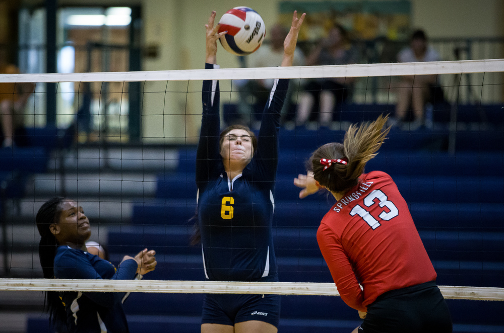 Southeast's Jordyn Rubin (6) tries to stop a shot from Springfield's Brooke Hadley (13) during the Girls City Volleyball Tournament at Southeast High School, Wednesday, Sept. 23, 2015, in Springfield, Ill. Justin L. Fowler/The State Journal-Register