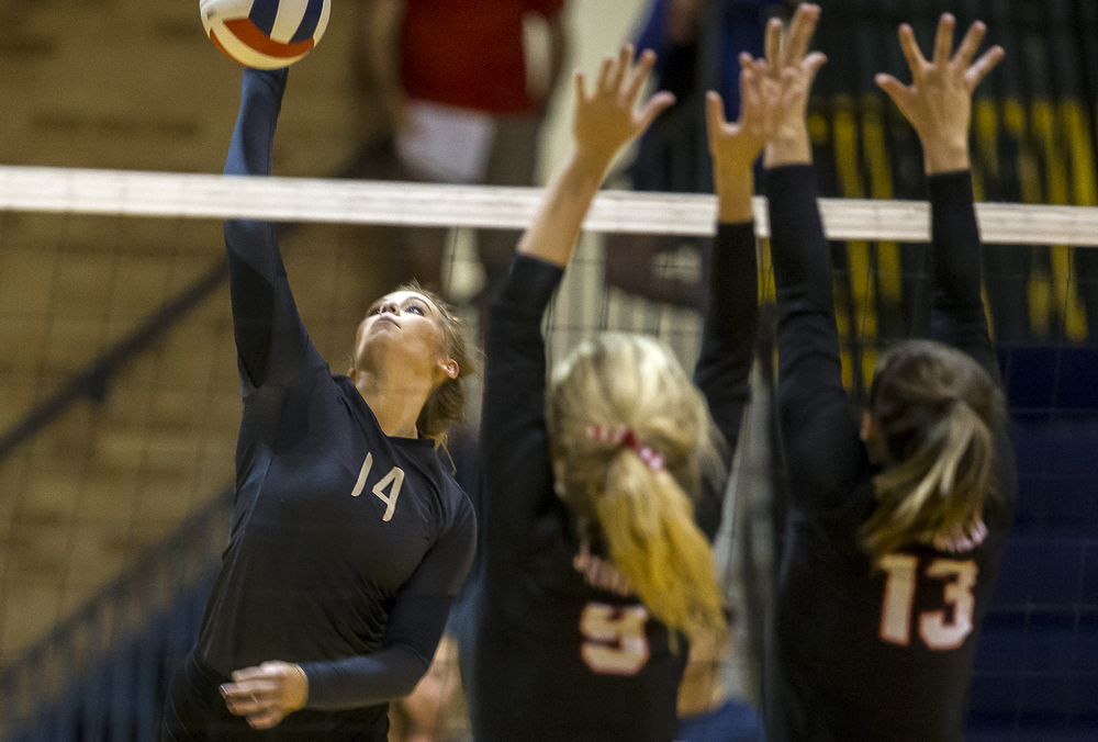 Sacred Heart-Griffin's Annie Urbance (14) fires a kill past Springfield's Kari Wilhelm (9) and Brooke Hadley (13) during the championship game of the Girls City Volleyball Tournament at Southeast High School, Thursday, Sept. 24, 2015, in Springfield, Ill. Justin L. Fowler/The State Journal-Register