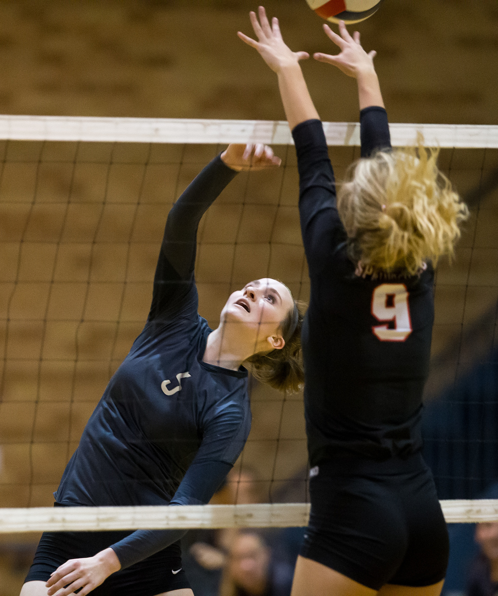 Sacred Heart-Griffin's Eilise Cummins (5) sends a shot over the reach of Springfield's Kari Wilhelm (9) during the championship game of the Girls City Volleyball Tournament at Southeast High School, Thursday, Sept. 24, 2015, in Springfield, Ill. Justin L. Fowler/The State Journal-Register
