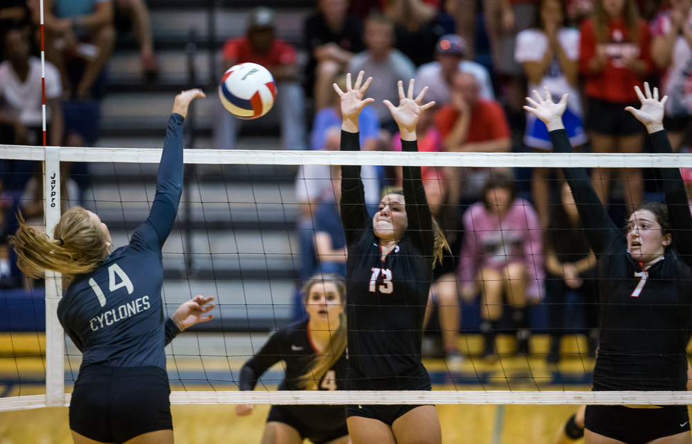 Sacred Heart-Griffin's Annie Urbance (14) fires a shot against Springfield's Brooke Hadley (13) during the championship game of the Girls City Volleyball Tournament at Southeast High School, Thursday, Sept. 24, 2015, in Springfield, Ill. Justin L. Fowler/The State Journal-Register