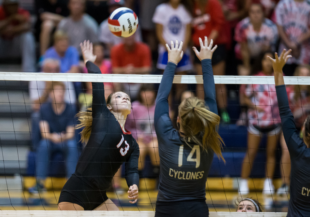 Sacred Heart-Griffin's Annie Urbance (14) leaps up to block the incoming shoot form Springfield's Brooke Hadley (13) during the championship game of the Girls City Volleyball Tournament at Southeast High School, Thursday, Sept. 24, 2015, in Springfield, Ill. Justin L. Fowler/The State Journal-Register