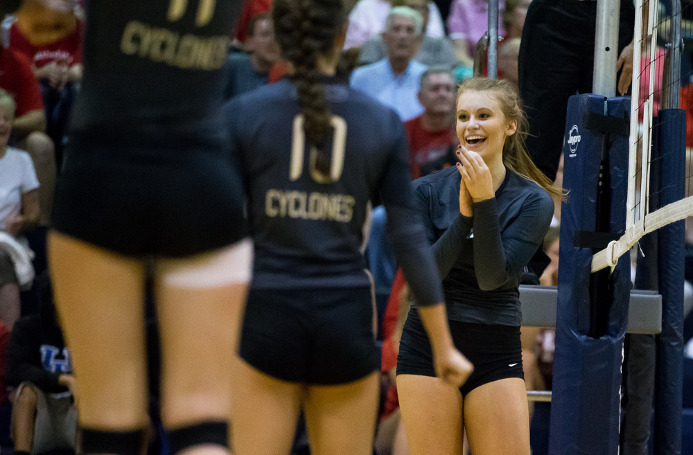 Sacred Heart-Griffin's Annie Urbance (14) begins to celebrate as the Cyclones come within two points of defeating Springfield during the championship game of the Girls City Volleyball Tournament at Southeast High School, Thursday, Sept. 24, 2015, in Springfield, Ill. Justin L. Fowler/The State Journal-Register