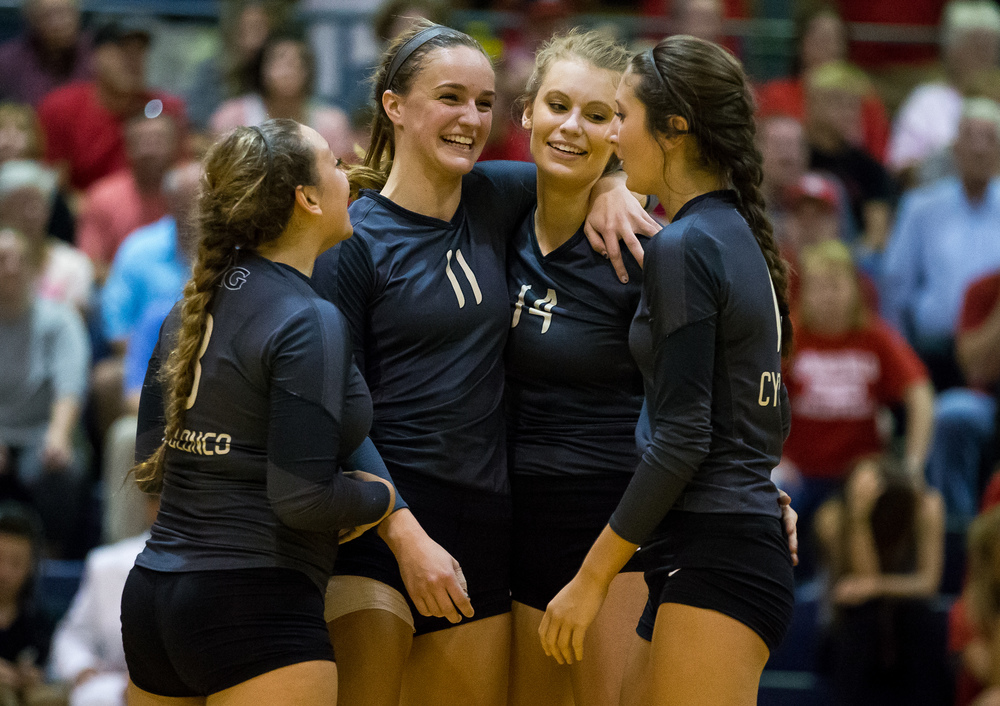 Sacred Heart-Griffin's Emma Hopkins (11) hugs Annie Urbance (14) as the Cyclones come within two points of defeating Springfield during the championship game of the Girls City Volleyball Tournament at Southeast High School, Thursday, Sept. 24, 2015, in Springfield, Ill. Justin L. Fowler/The State Journal-Register