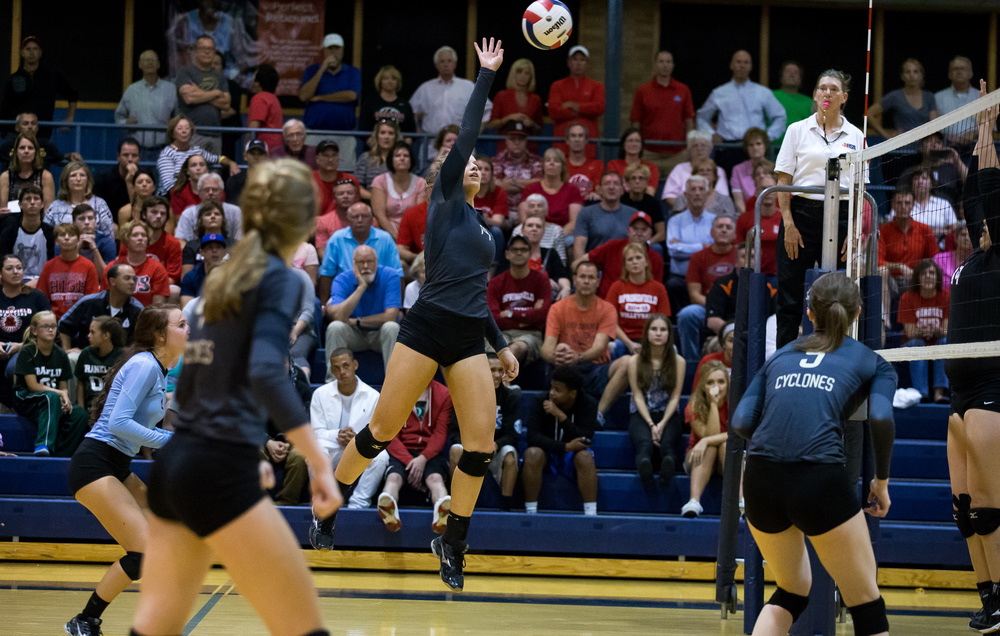 Sacred Heart-Griffin's Annie Urbance (14) puts up floating shot over the net against Springfield during the championship game of the Girls City Volleyball Tournament at Southeast High School, Thursday, Sept. 24, 2015, in Springfield, Ill. Justin L. Fowler/The State Journal-Register