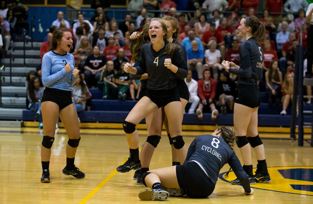 Sacred Heart-Griffin's Delaney Jordan (4) screams towards the bench as the Cyclones begin to celebrate their victory over Springfield in the championship game of the Girls City Volleyball Tournament at Southeast High School, Thursday, Sept. 24, 2015, in Springfield, Ill. Justin L. Fowler/The State Journal-Register