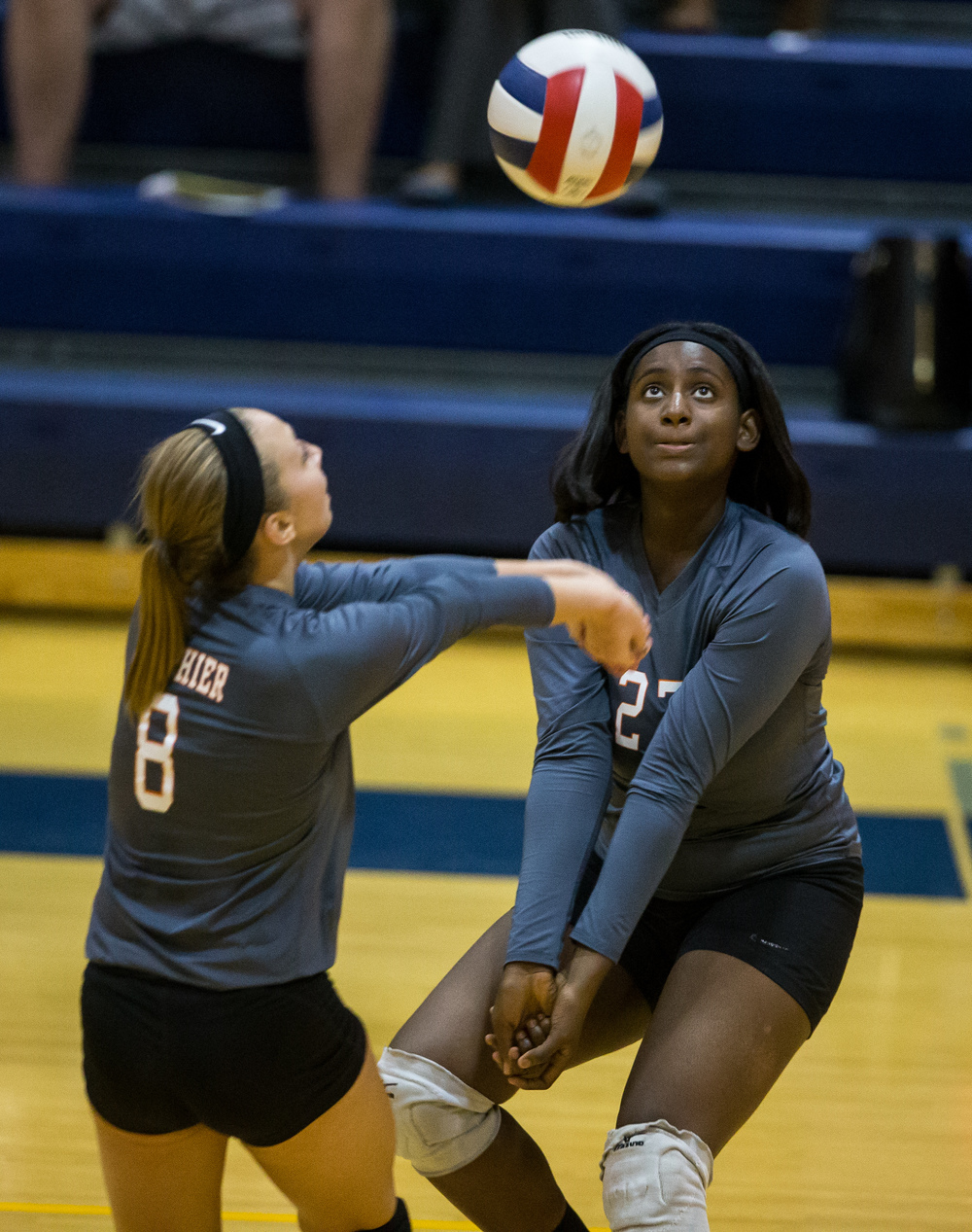 Lanphier's Autumn Tiller (27) and Haley Fitzgerald (8) go for a ball from Southeast during day three of the Girls City Volleyball Tournament at Southeast High School, Thursday, Sept. 24, 2015, in Springfield, Ill. Justin L. Fowler/The State Journal-Register