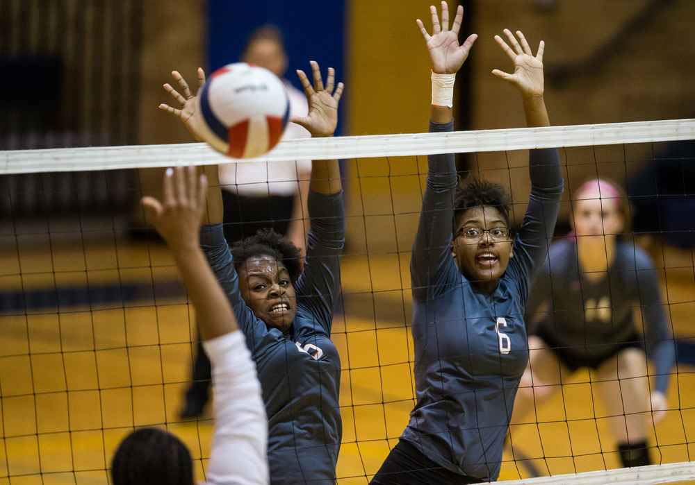 Lanphier's Correan Young (25) and Amari Smith (6) try to block a shot from Southeast's Jade Chambers-Jones (11)  during day three of the Girls City Volleyball Tournament at Southeast High School, Thursday, Sept. 24, 2015, in Springfield, Ill. Justin L. Fowler/The State Journal-Register