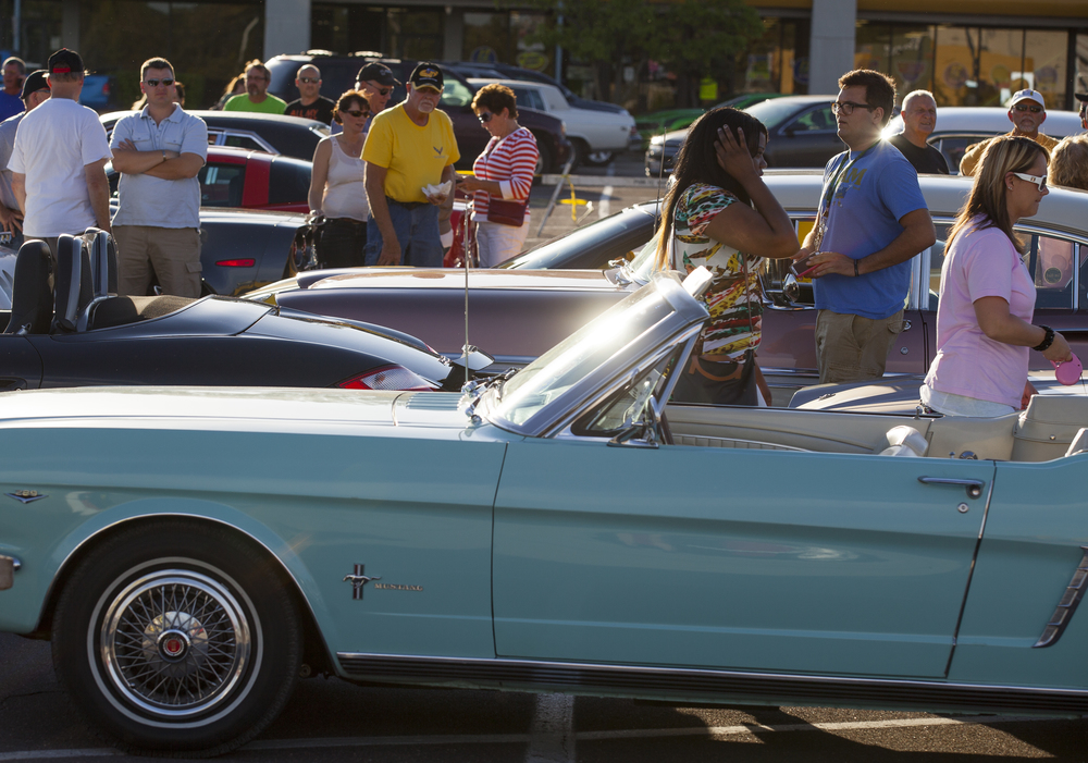 Cars lined up for the Route 66 Mother Road Festival cruise get a look Friday, Sept. 25, 2015 in the Capital City Shopping Center parking lot. Rich Saal/The State Journal-Register