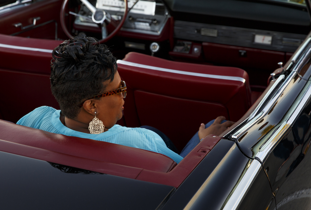 The leather seats in a friend's 1966 Lincoln Continental convertible were a comfortable place for Bonita Jackson, who waited for the start of the Route 66 Mother Road Festival cruise Friday, Sept. 25, 2015 in the Capital City Shopping Center parking lot. Rich Saal/The State Journal-Register