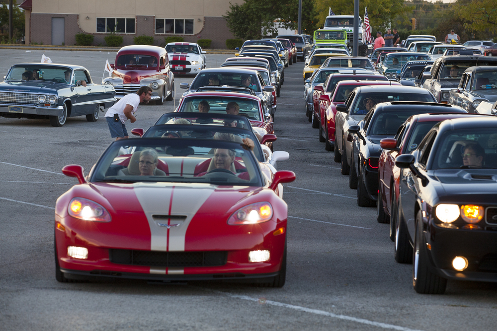 Cars participating in the Route 66 Mother Road Festival cruise leave the parking lot of the Capital City Shopping Center Friday, Sept. 25, 2015. Rich Saal/The State Journal-Register