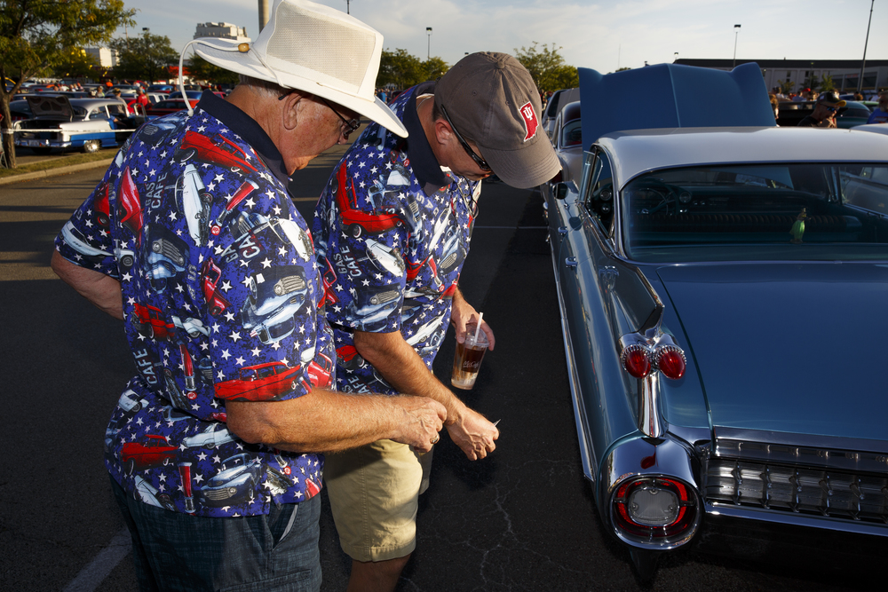 Michael Callahan and his son, Craig, from Indianapolis, Ind., look over a 1959 Cadillac before the Route 66 Mother Road Festival cruise begins Friday, Sept. 25, 2015, in the parking lot of the Capital City Shopping Center. Rich Saal/The State Journal-Register
