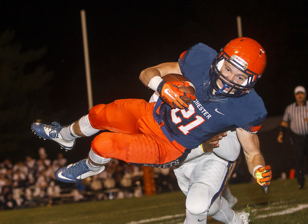 Rochester's Kenny Hedges gets airborne as he picks up yards against Southeast at Rochester High School Friday Sept. 25, 2015. Ted Schurter/The State Journal-Register
