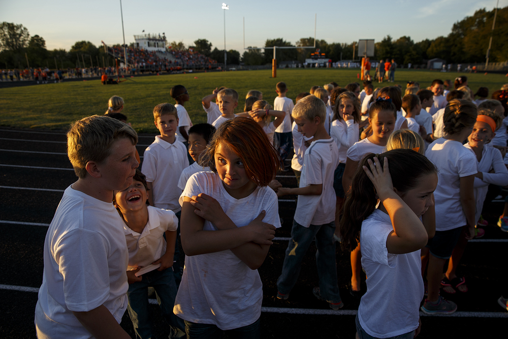 Third grade students from Rochester wait for their chance to sing the National Anthem and the school song before the Rockets face Southeast at Rochester High School Friday Sept. 25, 2015. Ted Schurter/The State Journal-Register