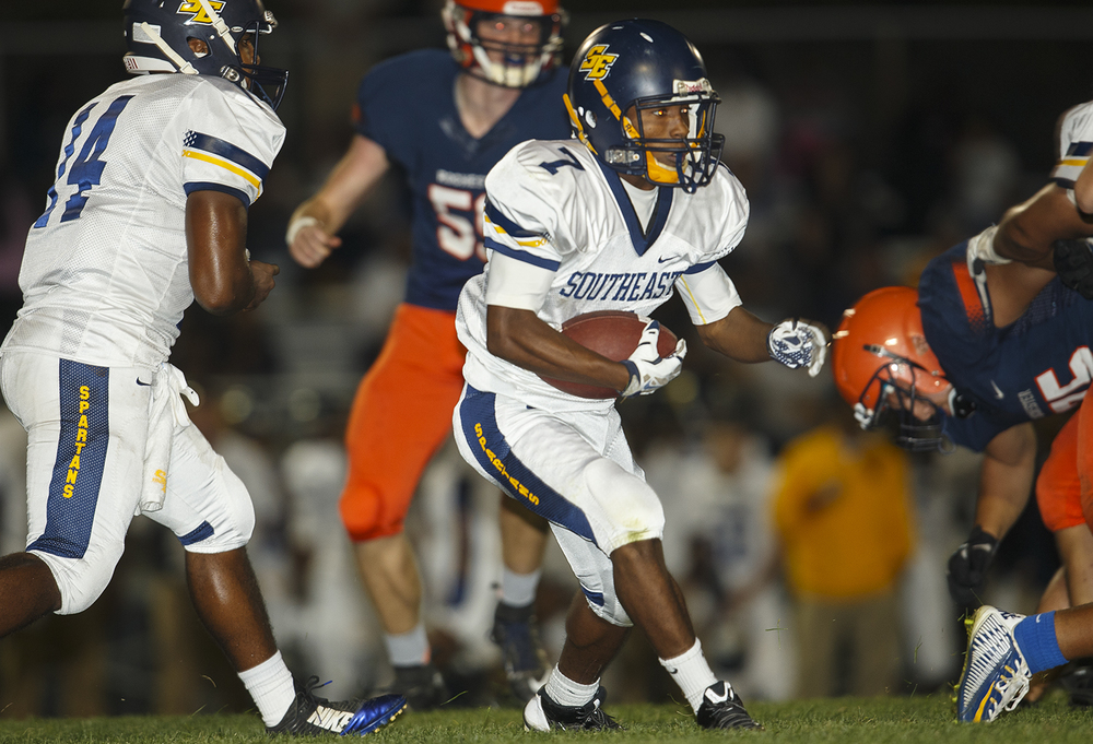 Southeast's Simeon Helem looks for an opening as he runs upfield against Rochester at Rochester High School Friday Sept. 25, 2015. Ted Schurter/The State Journal-Register