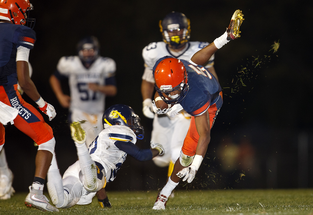 Rochester's Avante' Cox gets tripped up by a Southeast defender at Rochester High School Friday Sept. 25, 2015. Ted Schurter/The State Journal-Register