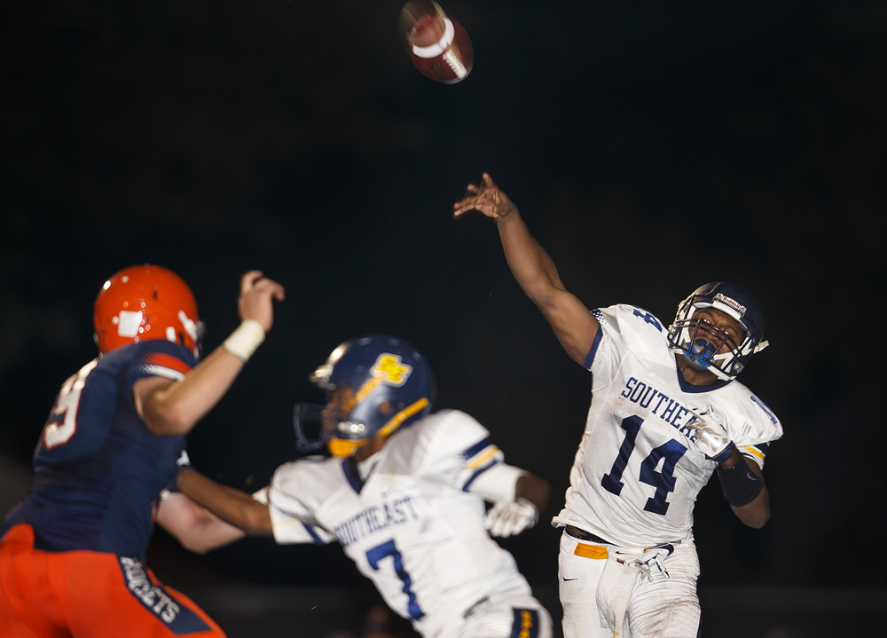 Southeast's Isaiah Timms fires a pass at Rochester High School Friday Sept. 25, 2015. Ted Schurter/The State Journal-Register