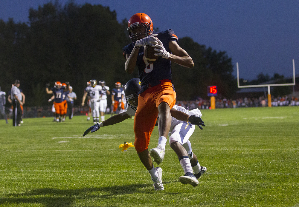 Rochester's Collin Stallworth high steps into the endzone after catching a pass from Danny Zeigler in the first half against Southeast at Rochester High School Friday Sept. 25, 2015. Ted Schurter/The State Journal-Register