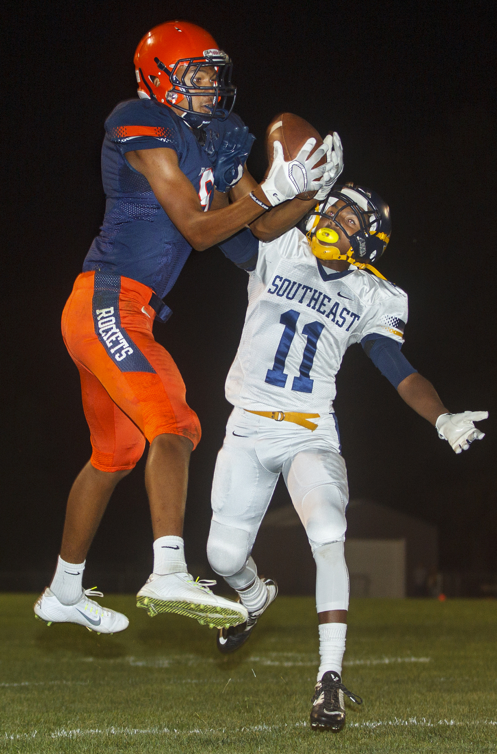 Rochester's Collin Stallworth catches a touchdown pass in front of Southeast's Darryl Williams Jr. at Rochester High School Friday Sept. 25, 2015. Stallworth caught three touchdown passes in the first half. Ted Schurter/The State Journal-Register
