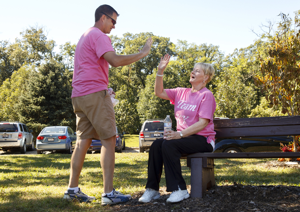 Scott McClure high fives his mother-in-law Karen DeMichael as she rests after walking a lap in the Multiple Sclerosis: One Step At A Time's 5K Multiple Sclerosis Walk for Central Ill. at Washington Park Sunday, Sept. 20, 2015. Ted Schurter/The State Journal-Register
